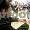 Katie Dahlstrom - kdahlstrom@shawmedia.com<br /> DeKalb High School junior Ashanta Burke, 17, scrolls through the playlist that members of the Black Student Union made for Black History Month. Students play the music during lunch Monday through Friday in the month of February.