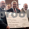 Katie Smith - ksmith@shawmedia.com<br /> DeKalb Mayor John Rey, State Rep. Bob Pritchard and Frontier Communications General Manager Thomas Kuschman pose with a $50,000 check for entering the quarterfinal of the America's Best Communities contest at Faranda's in DeKalb on Wednesday, June 17, 2015. The winnings will go toward developing an economic development plan that could put DeKalb into the running for $3 million.