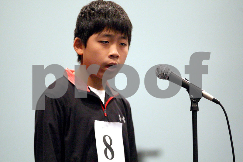 Monica Synett - msynett@shawmedia.com<br /> Joon Park, 13, of Sycamore Middle School in Sycamore, spells a word in the seventh round of the annual DeKalb County Spelling Bee at Kishwaukee College in Malta on Saturday, March 7, 2015.