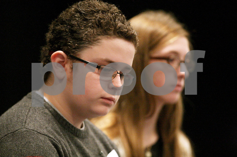 Monica Synett - msynett@shawmedia.com<br /> Nolan Bunger and Jessica Aubart are the final two spellers in the annual DeKalb County Spelling Bee at Kishwaukee College in Malta on Saturday, March 7, 2015. After 24 rounds, Bunger became the champion with a correct answer to a vocabulary question.