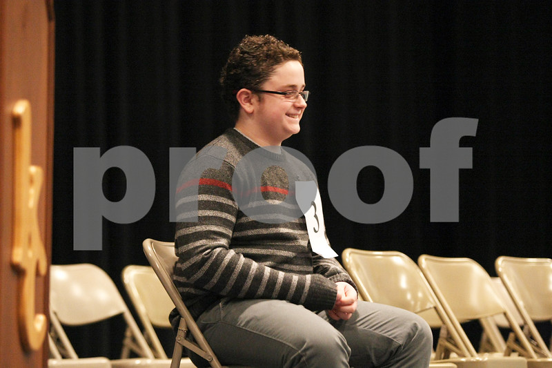 Monica Synett - msynett@shawmedia.com<br /> Nolan Bunger, 12, from Huntley Middle School in DeKalb smiles as he is named the champion of the annual DeKalb County Spelling Bee at Kishwaukee College in Malta after 24 rounds on Saturday, March 7, 2015.