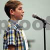 Monica Synett - msynett@shawmedia.com<br /> Torin Ladson, 13, from Sandwich Middle School in Sandwich, spells a word in the seventh round of the annual DeKalb County Spelling Bee at Kishwaukee College in Malta on Saturday, March 7, 2015.