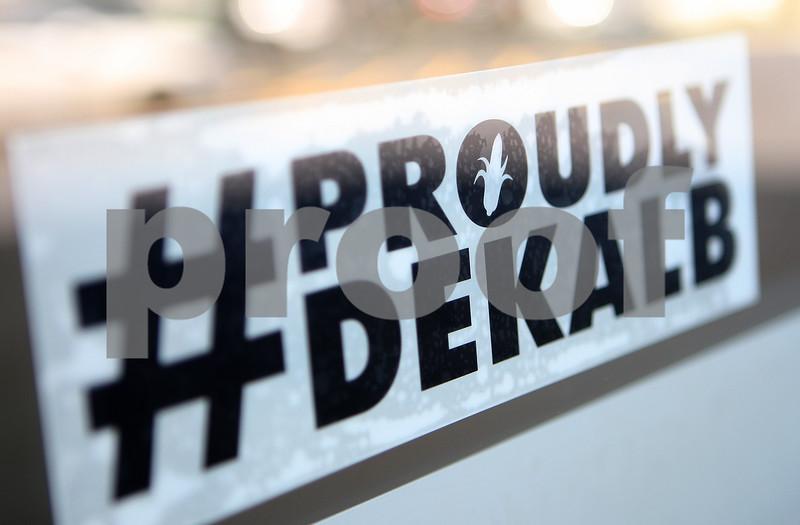 Danielle Guerra - dguerra@shawmedia.com<br /> A #ProudlyDeKalb bumper sticker hangs on the door of Faranda's on July 21 during the DeKalb State of the City breakfast in DeKalb. The stickers were handed out after the breakfast after the #ProudlyDeKalb initiative was announced.