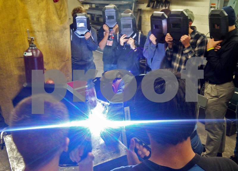 Adam Poulisse - apoulisse@shawmedia.com<br /> Area high school students watch a welding demonstation at Kishwaukee College as part of the third annual Heavy Metal Tour on Friday, October 2, 2015. The students toured local manufacturing plants and Kishwaukee College as part of the event.