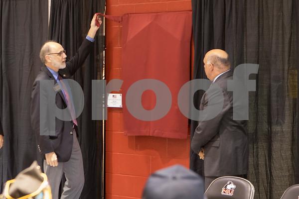 Sam Buckner for Shaw Media<br /> NIU president Doug Baker and NIU Athletic Director Sean Frazier unveil the restored WWII memorial on Friday, October 9, 2015.