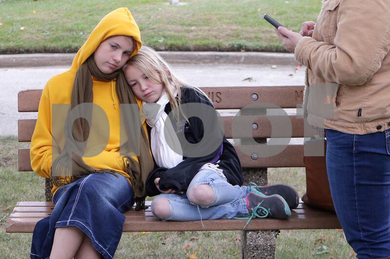 Sam Buckner for Shaw Media<br /> Charlotte (left), 11, and Noelle, 9, wait to go on the Elmwood Cemetery Heritage Walk on Sunday, October 4, 2015.