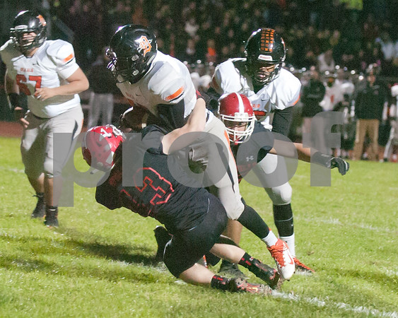 Dekalb senior David Long (45) carrys the ball for few yards before geting tackled that would lead to a touch down by David.