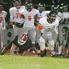 Dekalb senior Tony Tale (1) breaks a tackle and gains yards.