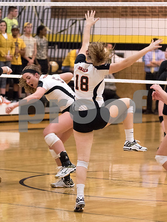 Sam Buckner for Shaw Media<br /> Heather Bemis and Morgan Newport celebrate after a point in the first game against Sycamore on Tuesday October 20, 2015. DeKalb won the series 2-1.