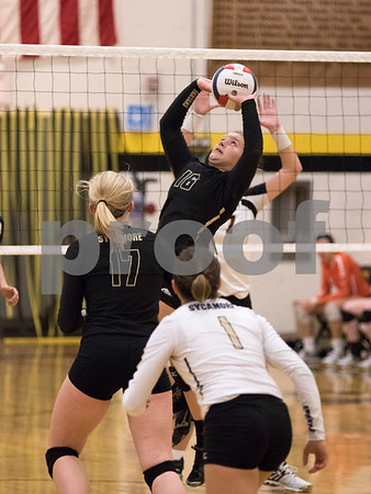 Sam Buckner for Shaw Media<br /> Valerie Hunt sets the ball in the third game against DeKalb on Tuesday October 20, 2015. DeKalb won the series 2-1.
