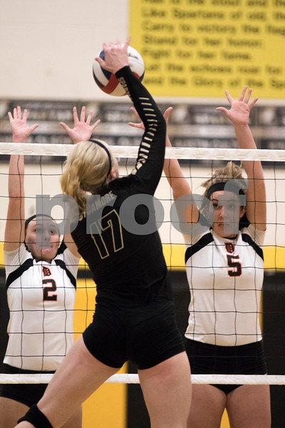 Sam Buckner for Shaw Media<br /> J.C. Longeville and Heather Bemis try to block a hit from Cassandra Hunt on Tuesday October 20, 2015. Barbs won the series 2-1.