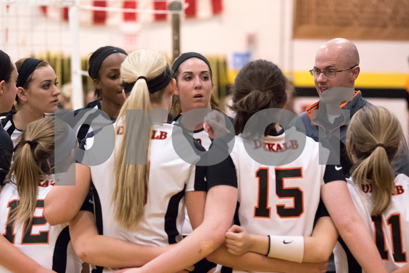 Sam Buckner for Shaw Media<br /> DeKalb coach Kyle Milborn talks to his team during a time out in the first game against Sycamore on Tuesday October 20, 2015. DeKalb won the series 2-1.