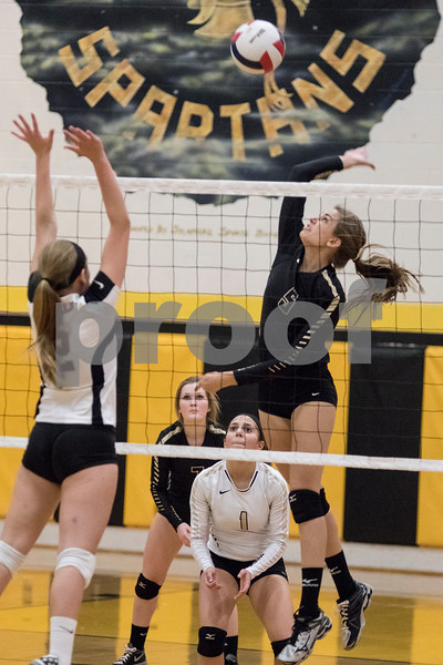 Sam Buckner for Shaw Media<br /> Maizy Larson spikes the ball in the first game against DeKalb on Tuesday October 20, 2015. DeKalb won the match 2-1.