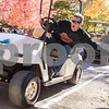 Sam Buckner for Shaw Media<br /> Jeff Donahoe, of the Sycamore Park Ditrict Golf Cart Drill Team, low fives kids as he drives by at the Pumpkin Parade on Sunday October 25, 2015.
