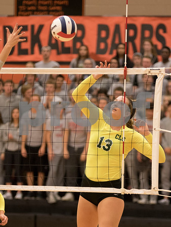 Sam Buckner for Shaw Media<br /> Kendall Kilberger hits the ball against DeKalb in third game of the championship match on October 29, 2015. The Gators won the match 2-1.