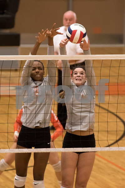 Sam Buckner for Shaw Media<br /> Jasmine Kemp and Hannah Oehlberg block the ball in the second game of the Regional Championship game against Crystal Lake South on October 29, 2015. Crystal Lake won the series 2-1.