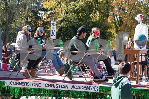 Sam Buckner for Shaw Media<br /> Students at Cornerstone Christian Academy sit at desks on their float at the Sycamore Pumpkin Parade on Sunday October 25, 2015.