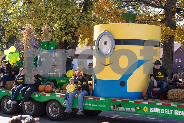 "A giant ""minion"" sits on the Sunbelt Rentals float at the Sycamore Pumpkin Parade on Sunday October 25, 2015."