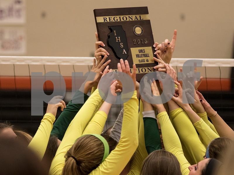 Sam Buckner for Shaw Media<br /> The Crystal Lake South Volleyball team holds up the regional championship plaque on October 29, 2015. The Gators won the series 2-1.