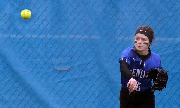 Geneva center fielder Anilise Bragg throws the ball toward second base during a game against visiting York on March 28.