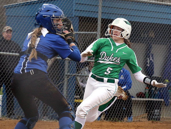 York's JoJo Moyer is forced out at home plate during a game at Geneva on March 28.