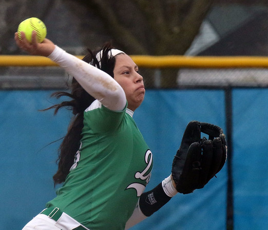 York third baseman Izzy Smith throws out a runner during a game at Geneva on March 28.
