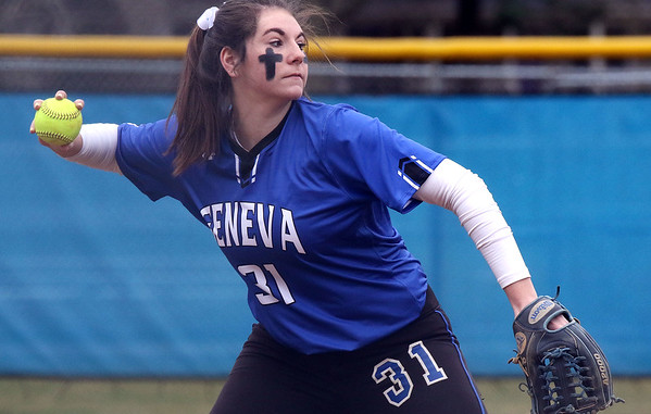 Geneva third baseman Molly Wrenn throws out a runner during a game against visiting York on March 28.