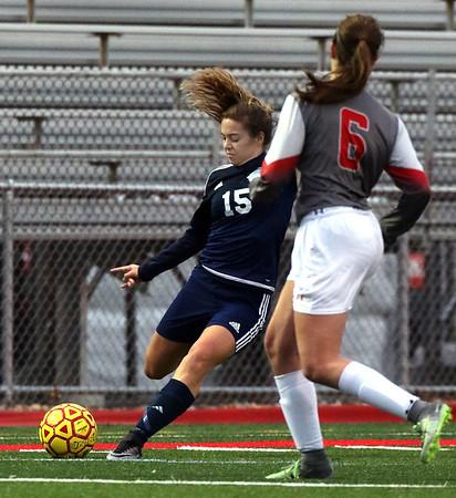 Nazareth's Maddie Mazur advances the ball during a game at Batavia on Thursday, March 30.