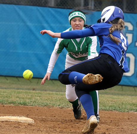 York second baseman Mia Tran has the ball knocked away by Geneva's Katie Keller as she slides into the bag during a game in Geneva on March 28.