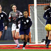 Nazareth's Claire Ramsey (#14) and Angelica Ariola (#2) run toward the ball after a Batavia corner kick during a game in Batavia on Thursday, March 30.