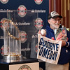 Rick Albright of Aurora poses with the Commissioner's Trophy as part of the Chicago Cubs World Championship Trophy Tour at the Paramount Theatre in Aurora April 3.