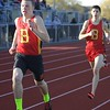 Batavia leads the way in heat 1in the 800-meter run during the boys track and field invite at St. Charles North High School April 7.