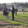 Geneva's Evan Rutledge competes in the long jump during the boys track and field invite at St. Charles North High School April 7.
