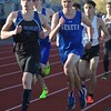 St. Charles North and Geneva battle it out in the 800-meter run during the boys track and field invite at St. Charles North High School April 7.
