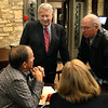 Batavia Mayor Jeff Schielke (standing, left) has a conversation with residents during election night at Pal Joey's in Batavia.  Schielke claimed victory in his re-election bid over challenger Jason Stoops.