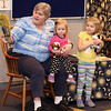 Hailey and Makayla Connolly of St. Charles, participate in an interactive part of Pajama Story Time with Youth Servces Librarian Carol Leeson on April 7 at the St. Charles Library.