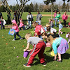 Kids in the 5-7 year old division start collecting eggs during the Elburn Lions Club Easter Egg Hunt on April 8 in Elburn.