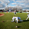 (Left to right) Kane County Cougars players Luis Basabe, Luis Silverio and Ramon Hernandez kneel for a moment of reflection before the team's home opener against the Clinton LumberKings at Northwestern Medicine Field in Geneva April 6.