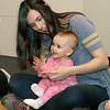 Becky Van Dyke helps daughter Cora, 10 months, clap her hands during Pajama Story Time at the St. Charles Public Library. Participants were invited to come dressed in their favorite pajamas and bring along a blanket or stuffed toy.