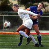 St. Charles North's Gia Wahlberg keeps Lyons Township's Catherine Johnson away from the ball chase during a game at Batavia High School on April 13.