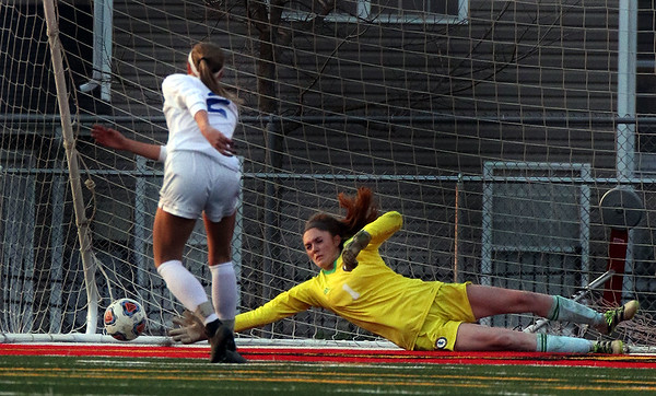 Lyons goal keeper Claire Purcell dives but fails to make the save on a St. Charles North penalty kick during a game at Batavia High School on April 13.