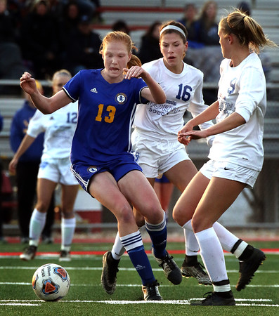Lyons' Eileen Murphy looks to control the ball during a game against St. Charles North at Batavia High School on April 13.