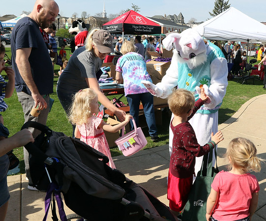 The Easter Bunny greets children during an Egg Hop at the Peg Bond Center in Batavia April 15.
