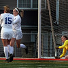St. Charles North's Hailey Rydberg, third from left, celebrates a penalty kick goal past Lyons Township goal keeper Claire Purcell, right, during a game at Batavia High School on April 13.