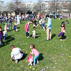 Children gather eggs during an egg hunt at the Peg Bond Center in Batavia April 15.