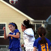 Lyons' Caroline Murphy heads the ball during a game against St. Charles North at Batavia High School on April 13.