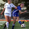 Lyons' Elizabeth Hall advances the ball while defended by St. Charles North's Amanda Czerniak during a game at Batavia High School on April 13.