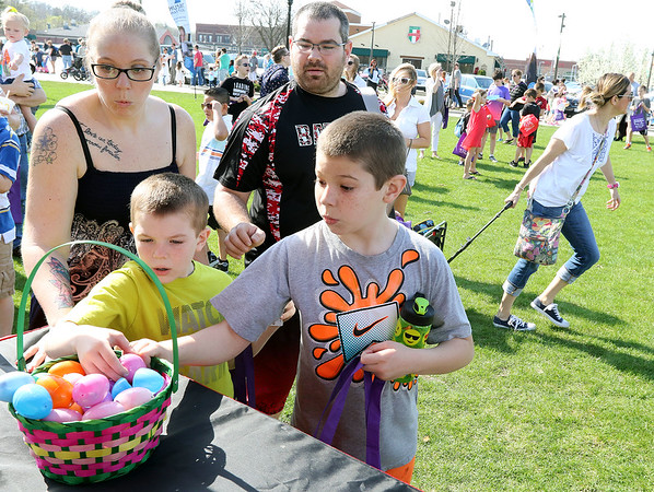 Children grabs eggs from a basket during an Egg Hop at the Peg Bond Center in Batavia April 15.