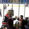 Chicago Steel mascot Rusty greets a fan during game one of the USHL's Western Conference semifinal against Youngstown at the Fox Valley Ice Arena. The Steel won 4-1.