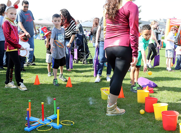 Children play games during an Egg Hop at the Peg Bond Center in Batavia April 15.